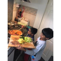 Gagana cooking with his brother