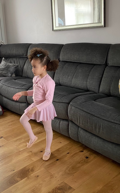 Charis doing her ballet lesson.