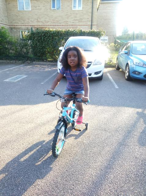 Queen-Esther riding her bike!
