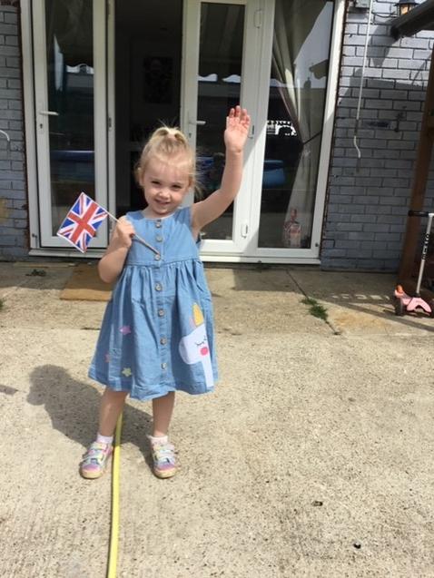 Scarlett waving her Union Jack Flag on VE75 Day.