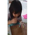Tabita painting her hand