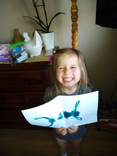 Anika's very proud of her painting!