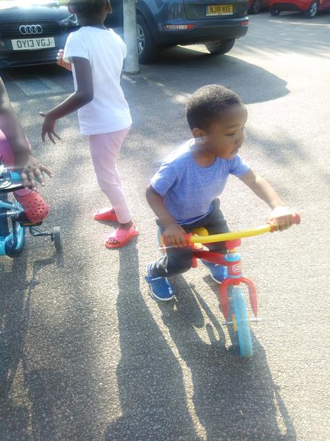 Crown enjoying the good weather, riding his bike.