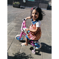 Sanuli riding her bike