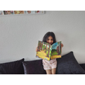 Sanuli looking at her Gruffalo book