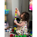 Mia making a very tall tower