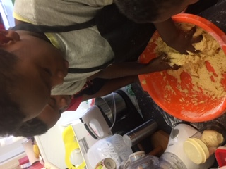 Agozie and his brothers doing some baking.
