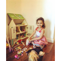 Diyenka playing with her dolls house