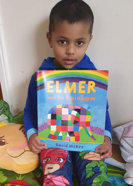 Riyon and his favourite book Elmer and the Rainbow