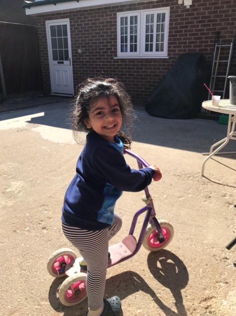 Amaya riding her scooter.