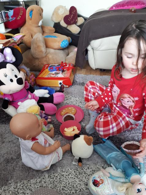 Zoe having a tea party with her toys!