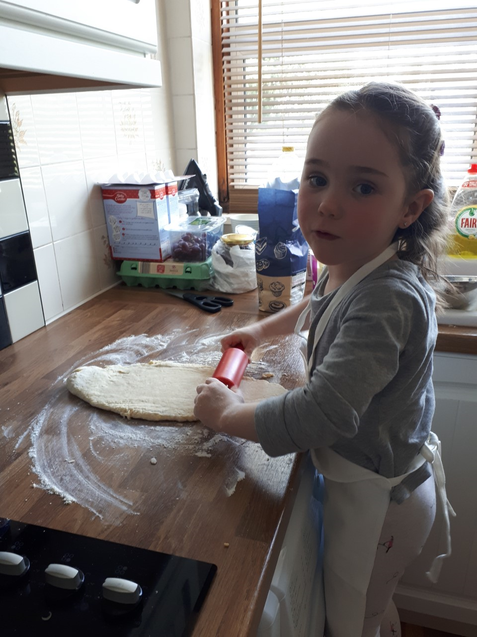 Zoe's busy in the kitchen doing some baking.
