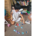 Thenuki doing her Cars jigsaw puzzle