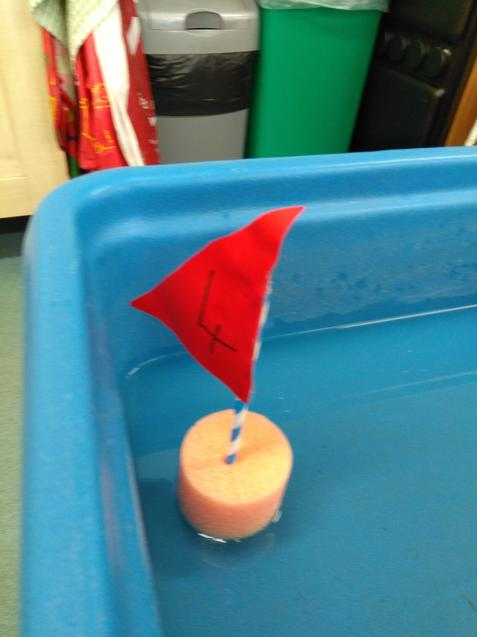 One little red sail boat