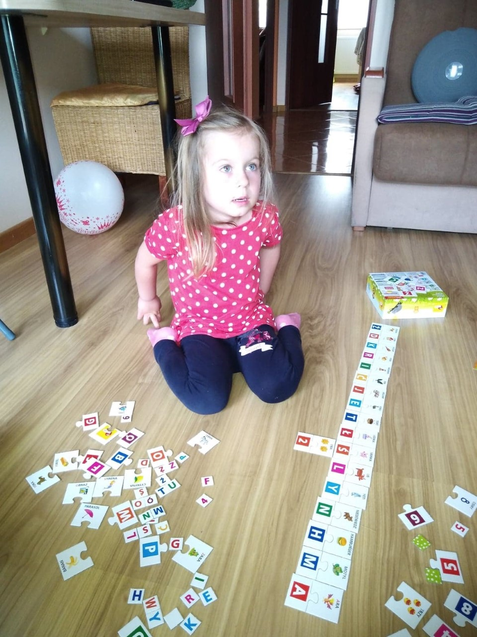 Anika is busy building her puzzle.
