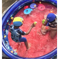 Jevindu splashing with his brother in the pool