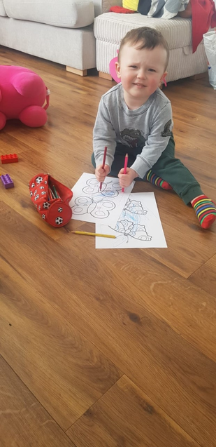 Alex is busy doing some mark making.