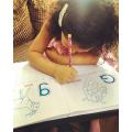 Diyenka practising her letter formation