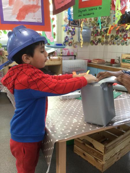 Alvin wears his space helmet!