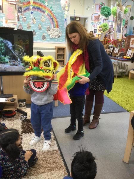 Mrs Bodle shows us the dragon mask
