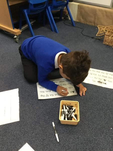 Aryan practices his letter formation