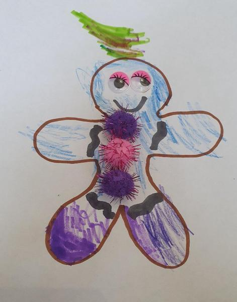 Aisha makes a Gingerbread Man drawing