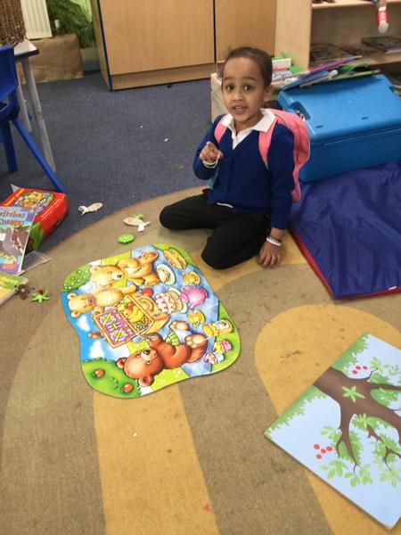 Razeena completes a jigsaw independently