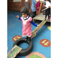 Humaira balances across the obstacle course.