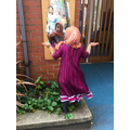 Amina enjoys dressing up and dancing!