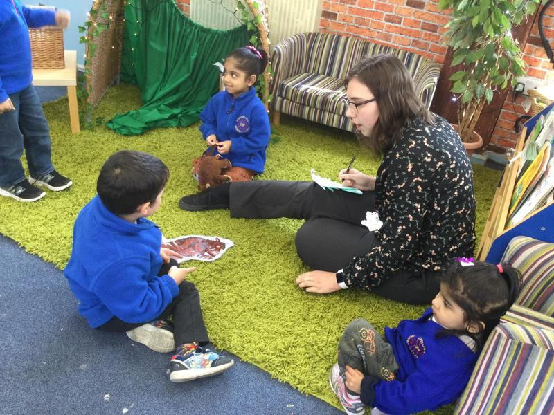 The children talk to Miss Lewin.