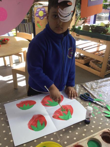 Muh Shah paints 4 strawberries