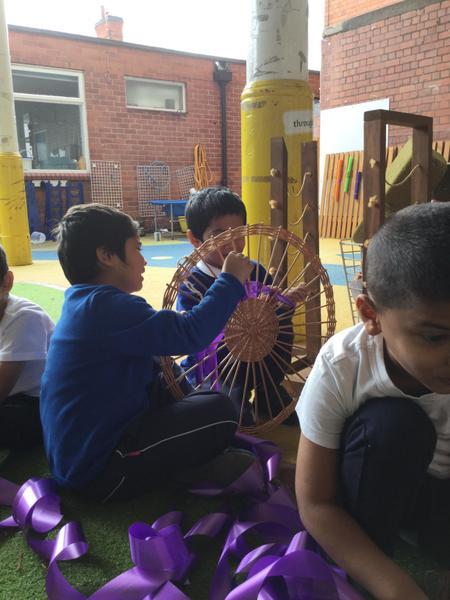 Sajid and Simon work together to improve their fine motor skills
