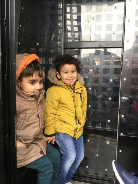 Haroun and Mustrafaraza get in the police van