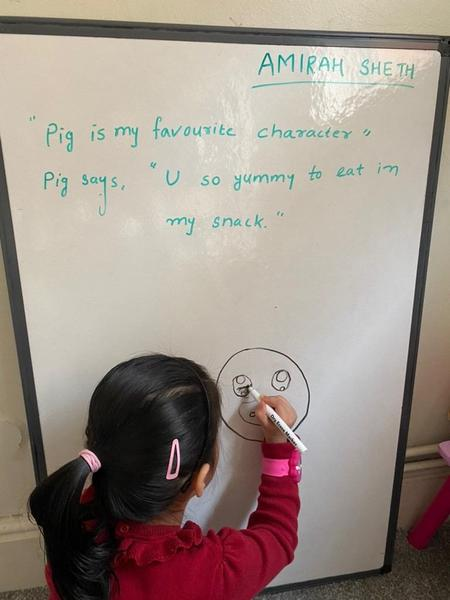 Amirah draws her favourite character. A pig