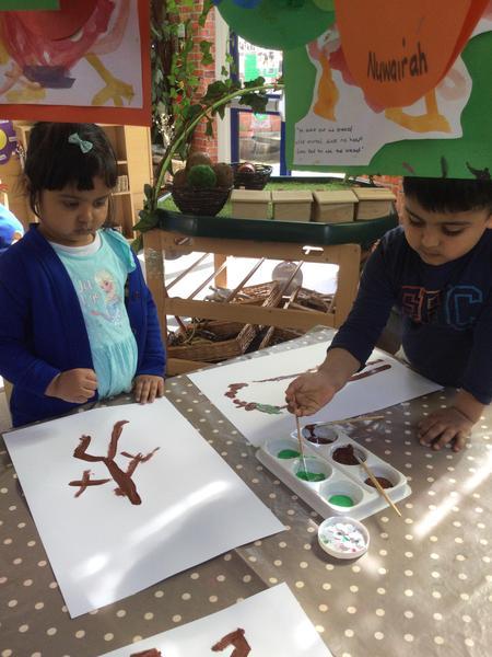 Anwara and Ritik paint stickman.