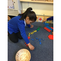 Kruti sorts the colours of the dinosaurs