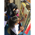 Faatimah and Guntaas explore with painting.