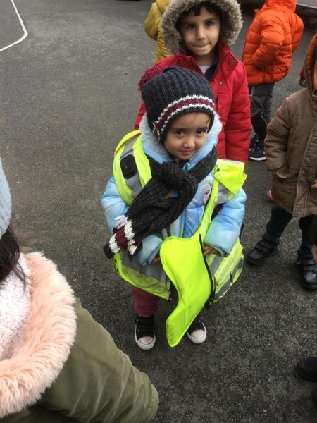 Dharika wears a big police jacket.