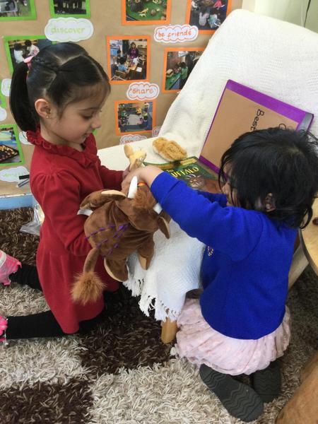 Amirah and Zainab use the hand puppets