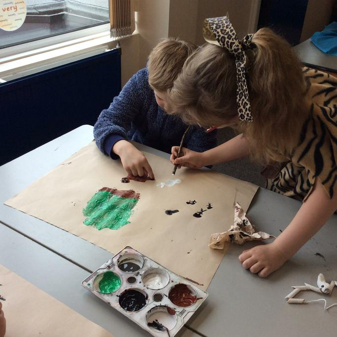 We used twigs to paint Stone Age pictures