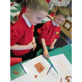 Using clay skills to make a plaque