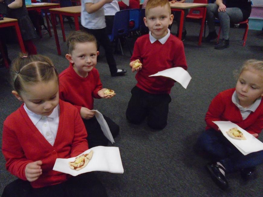 Tucking into the pizzas.
