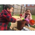 Saskia and her brother planting