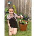 Saskia proud of her plants