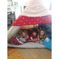 Quinn with siblings in homemade Tipi