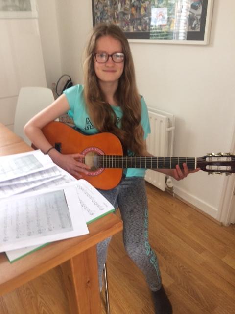 Elena practising guitar