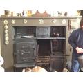 The range cooker kept the room warm.