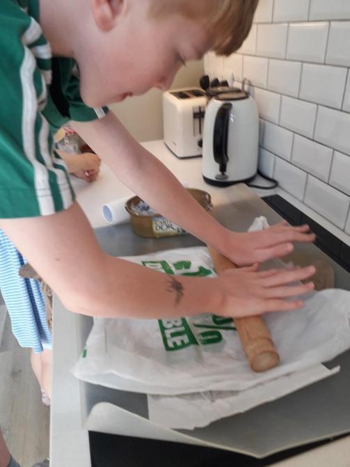 Louis making paper