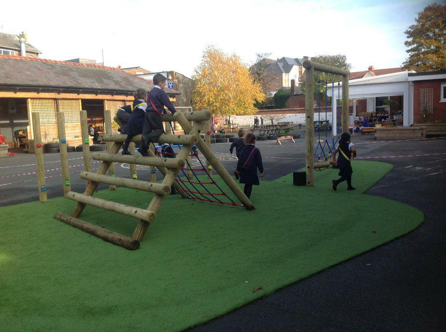 Climbing and balancing outdoors in EYFS