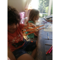 Quinn making a model aeroplane